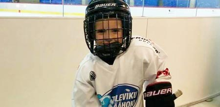 A young hockey player with Frontier hockey stick